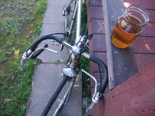 A steel bike and a glass of beer